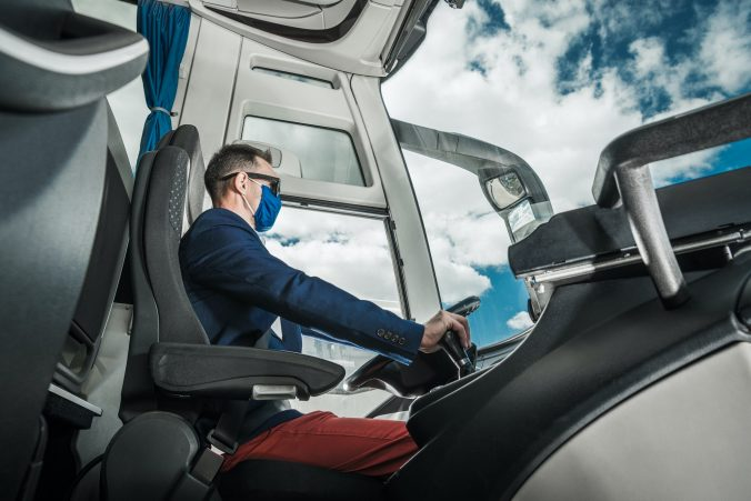 Shuttle Coach Bus Driver Inside the Modern Vehicle